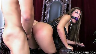 Submissive bitch helter-skelter corset Capri Cavalli gets her mouth and pussy fucked